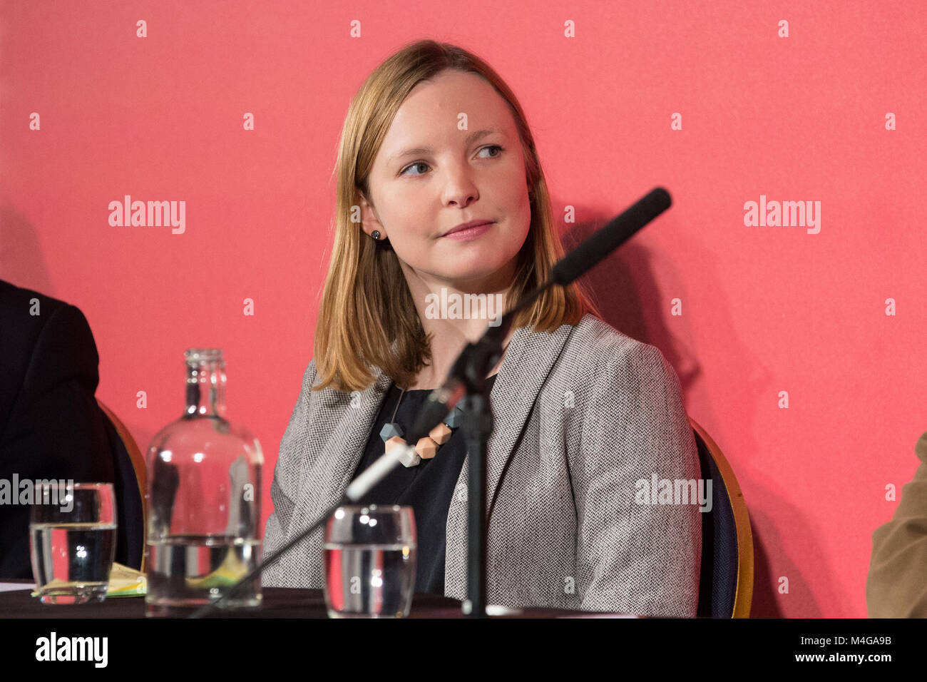 London, UK. 10th February, 2018. Cat Hobbs, founder and director of We Own It, listens to speeches at the Labour's - Stock Image