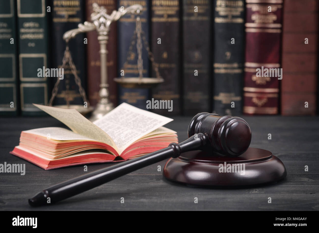 Law and Justice, Legality concept, Scales of Justice and Judge Gavel on a black wooden background. - Stock Image
