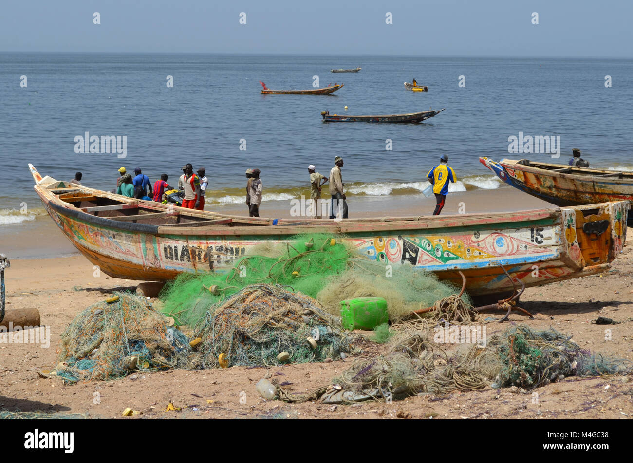 Artisanal wooden fishing boats (pirogues) in the Petite Côte, Senegal - Stock Image