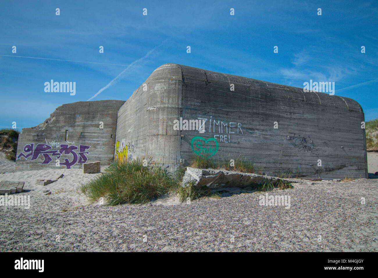 "Old bunker of Wolrd war 2, with a ""free room"" slogan on it. On Grenen Beach in Skagen, Denmark, Europe, Shot June Stock Photo"