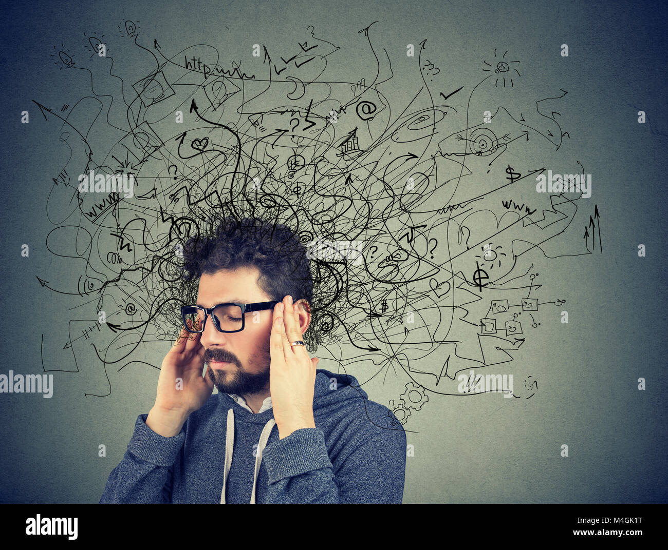 Thoughtful stressed young man with a mess in his head - Stock Image