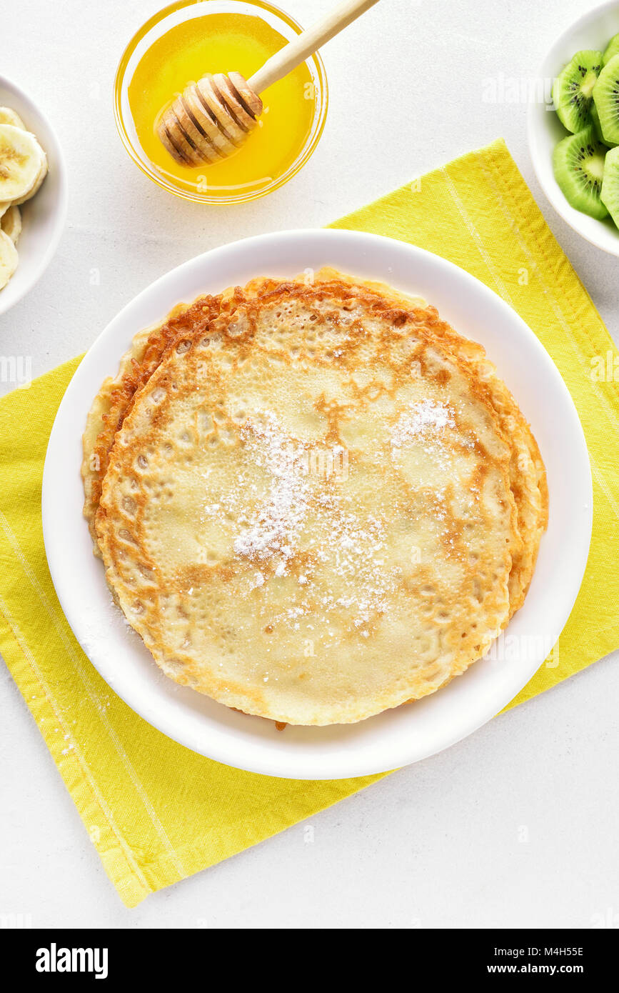 Thin pancakes, sweet crepes. Top view, flat lay - Stock Image