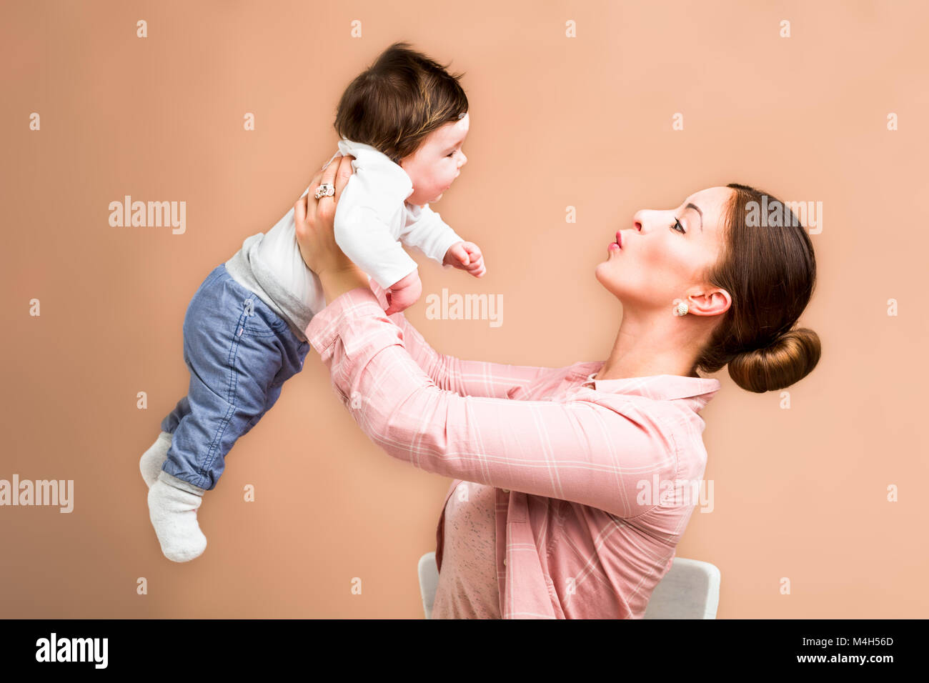mother and six months old baby girl - Stock Image