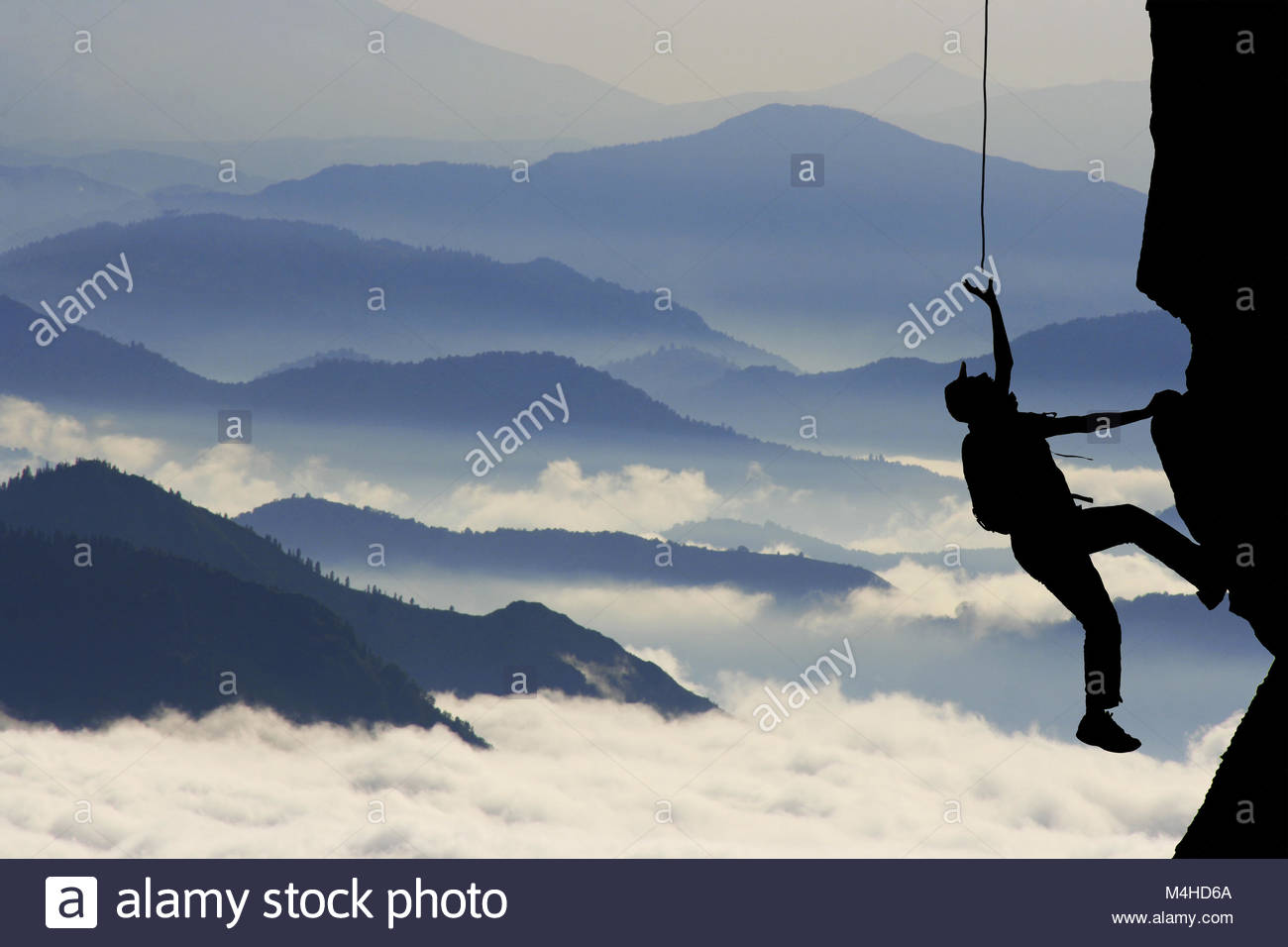 Climbing difficulties and help - Stock Image