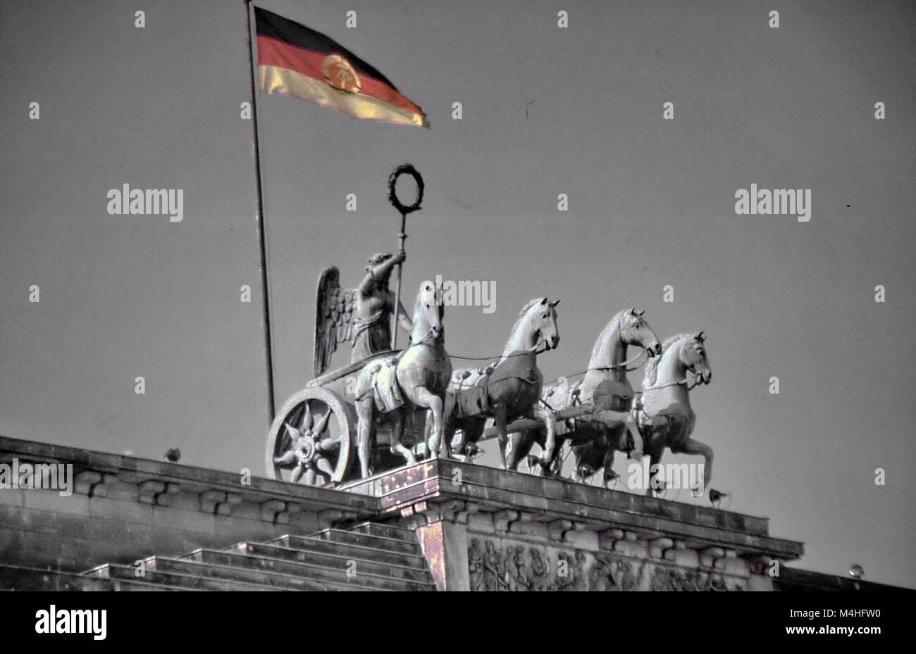 The Quadriga on the Brandenburg Gate with the flag of the German Democratic Republic. - Stock Image