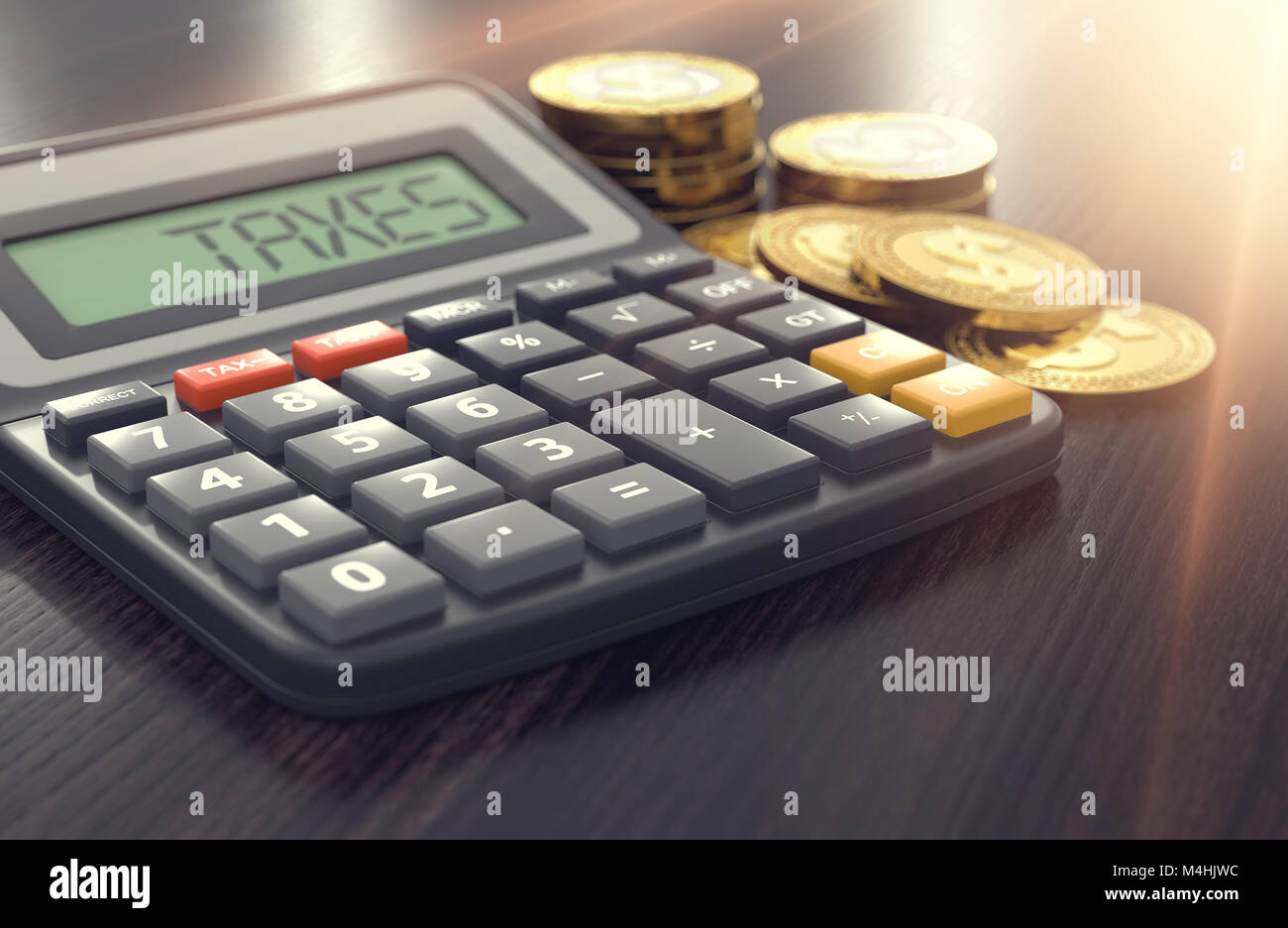 Calculator with the word TAXES on the display and golden coins and sun flare in the background. Income Tax concept. Stock Photo