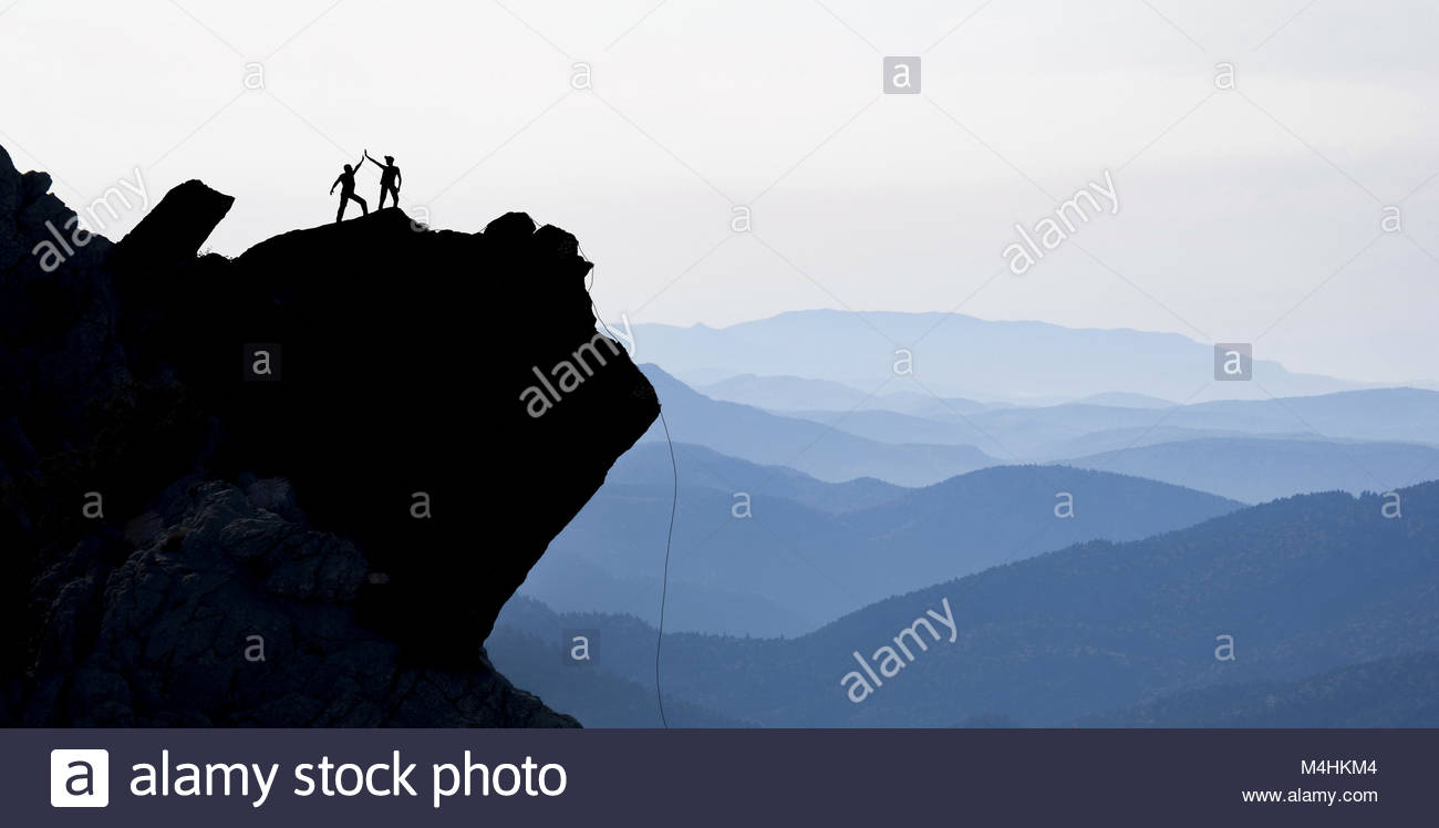 challenging rock climbing and success - Stock Image