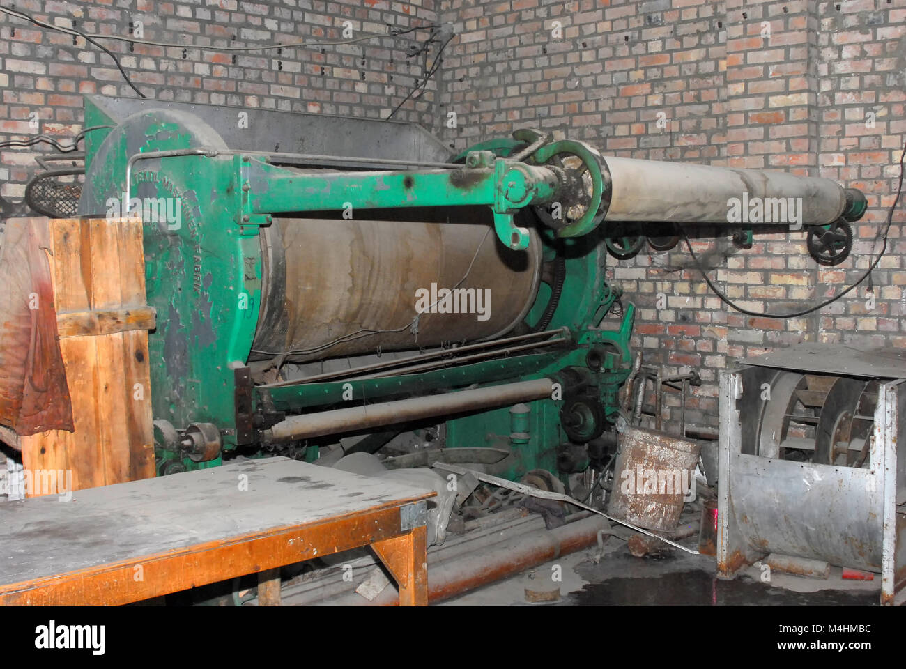 Old dysfunctional vintage machinery used for the production of textiles - Stock Image