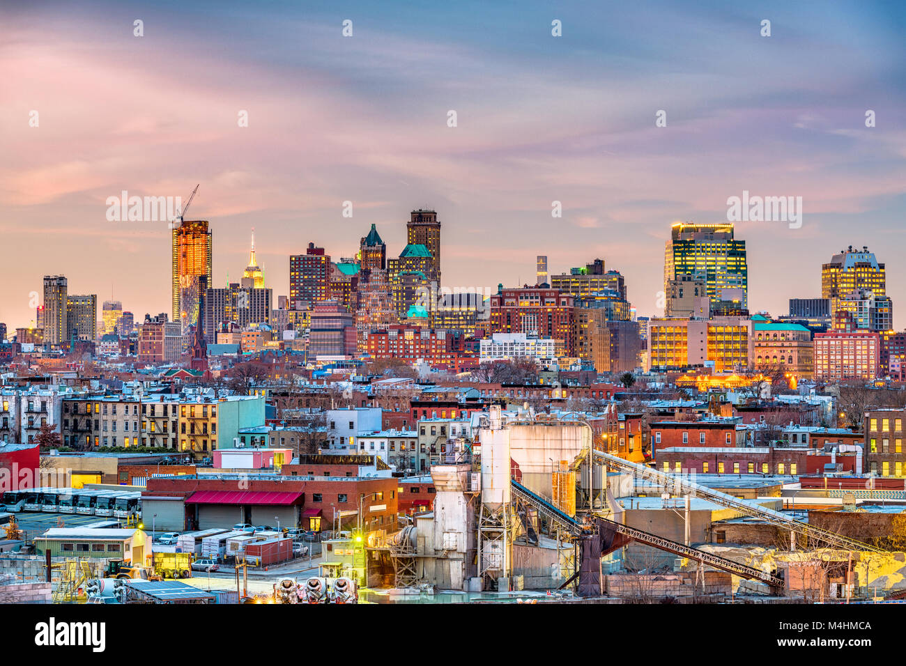 Brooklyn, New York, USA skyline with industrial areas at dusk. - Stock Image