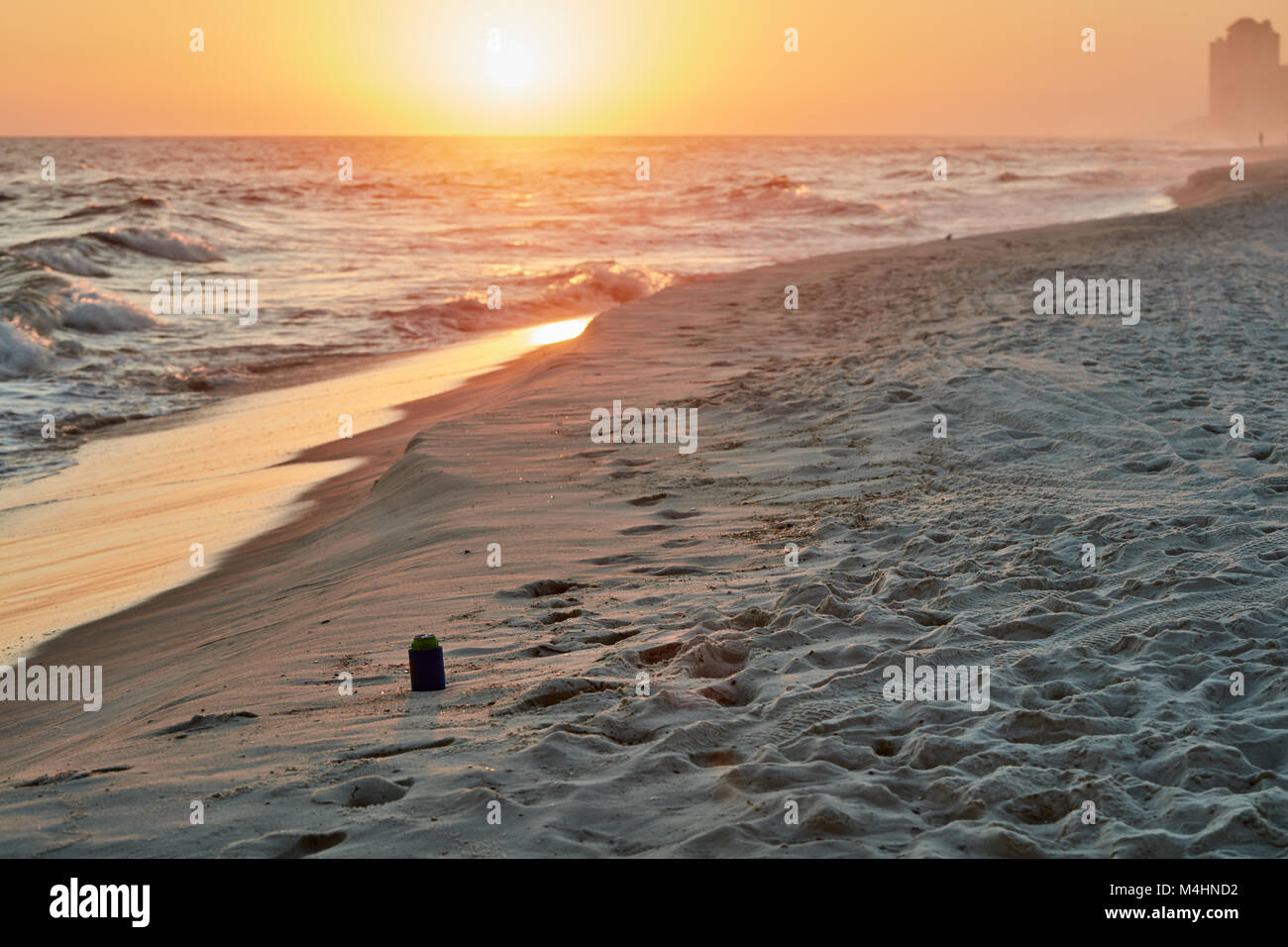 Abandoned soda can on the beach at sunset, Gulf State Park, Alabama Stock Photo