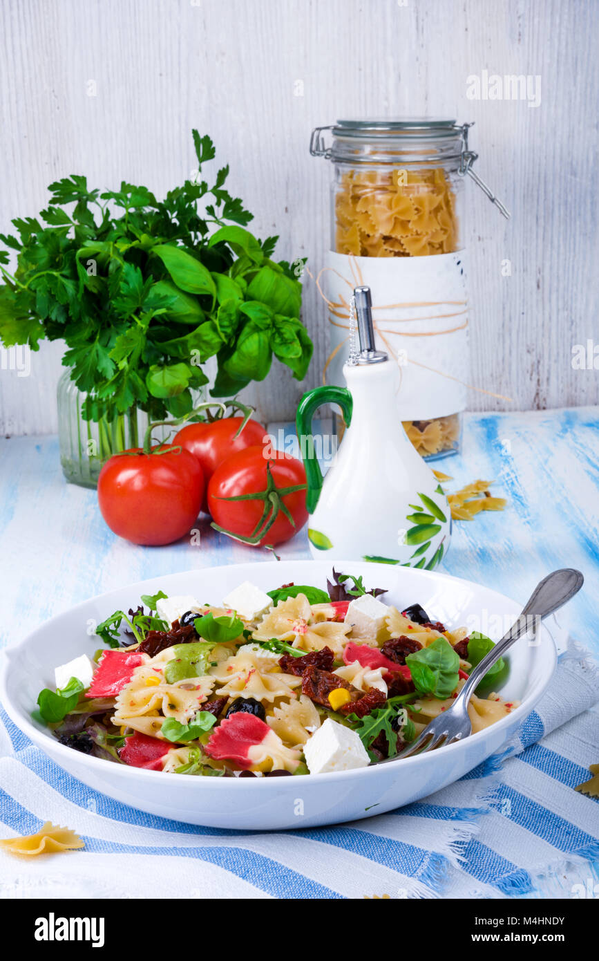 Mediterranean Farfalle salad with dry tomatoes and pine cores - Stock Image