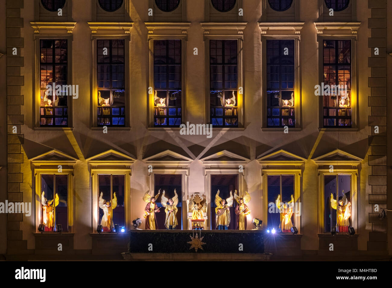 Illuminated angelic play at the town hall by night, Christmas market, Augsburg, Swabia, Bavaria, Germany - Stock Image