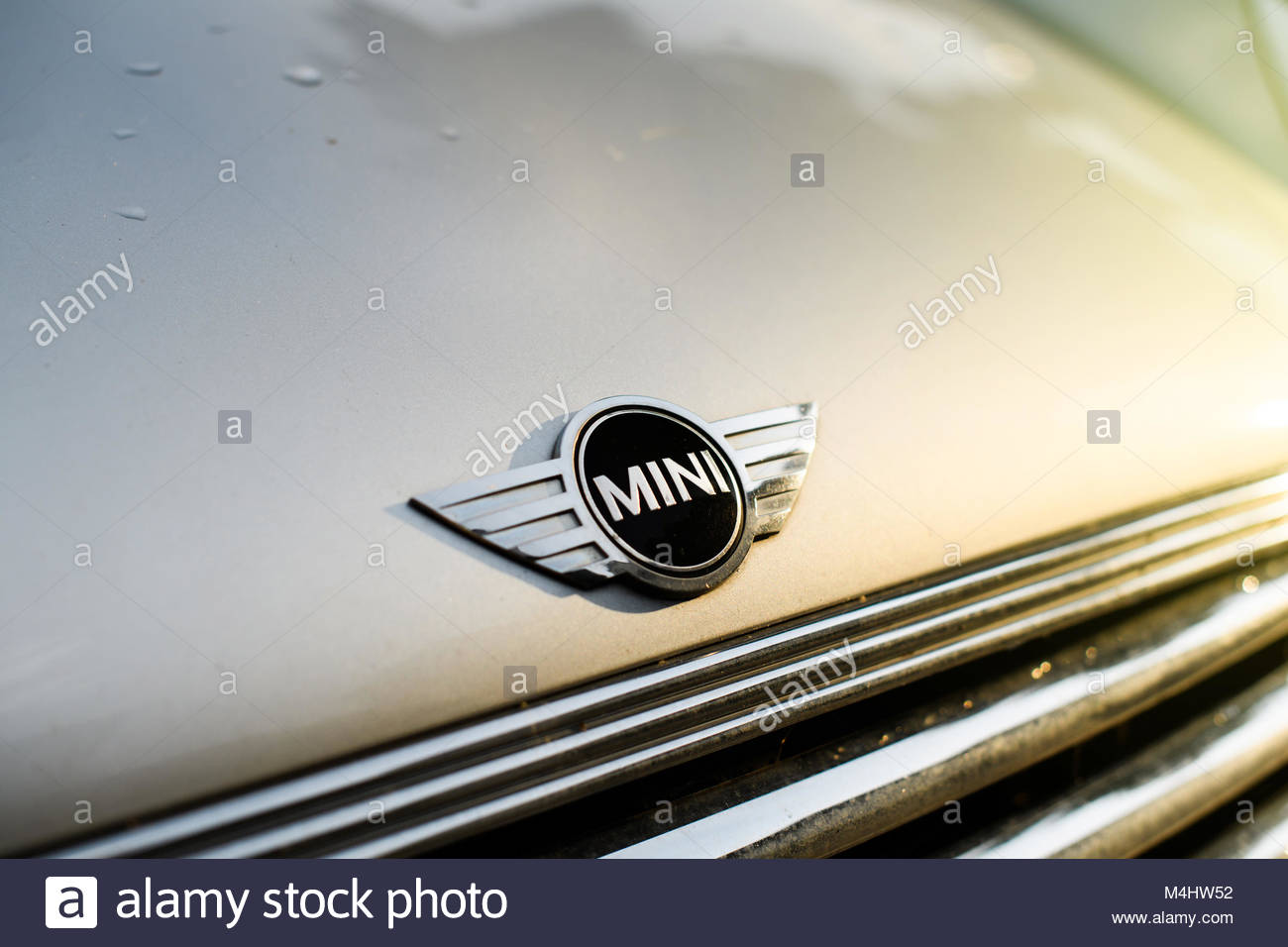 Mini car parked in city with mini logotype - Stock Image