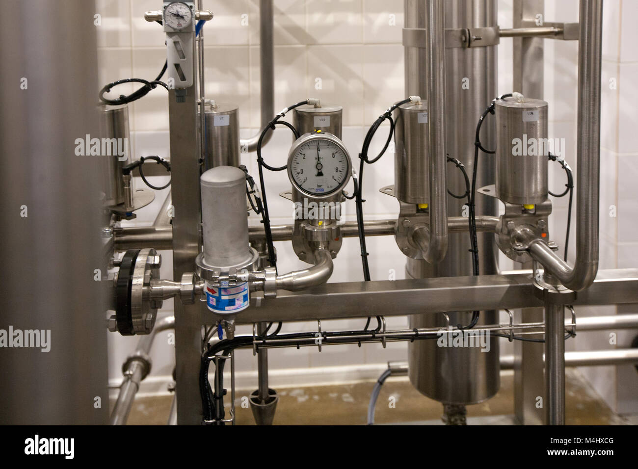 Pressure gauge (manometer) of white metal -  brewing equipment. Close-up, macro. - Stock Image