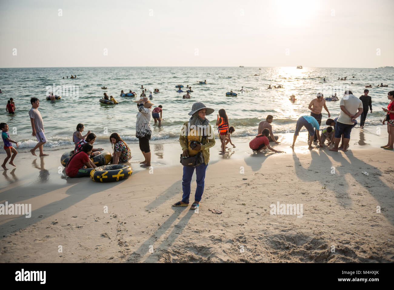 Views of the crowded beach of Sihanoukville, Cambodia at sunset. - Stock Image