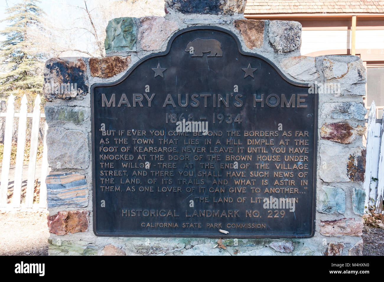 Mary Hunter Austin Plaque memorializing her in front of her house in Independence, California. - Stock Image