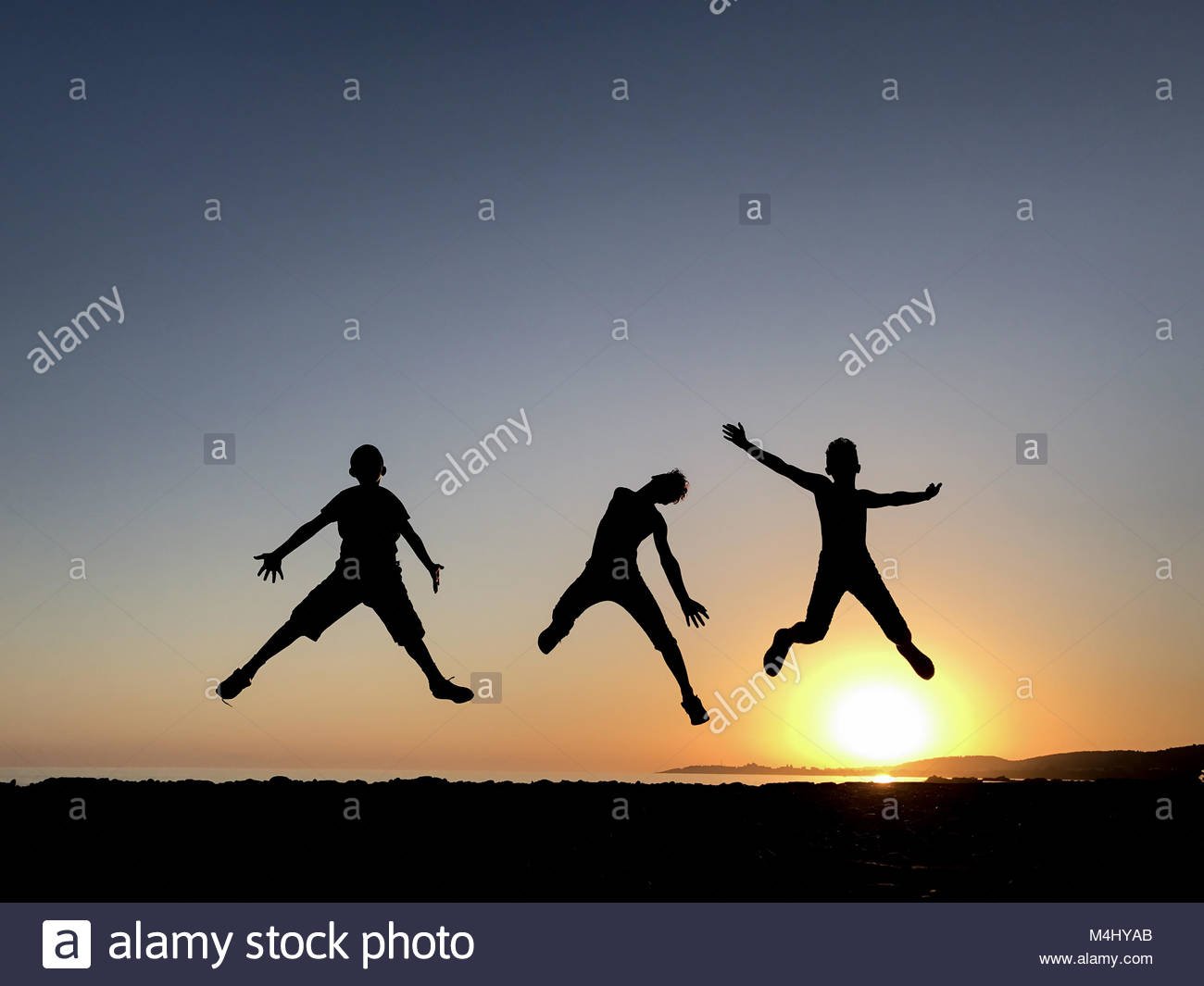 Jumping of energetic and dynamic youngsters - Stock Image