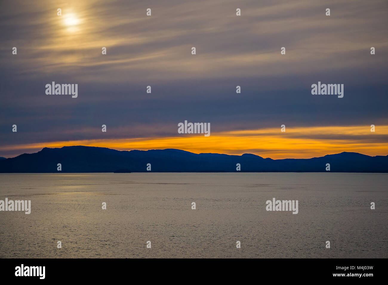 sunset and alaska mountains in mud bay Stock Photo