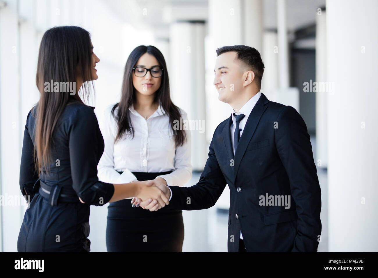 Business people shaking hands, finishing up a meeting - Stock Image