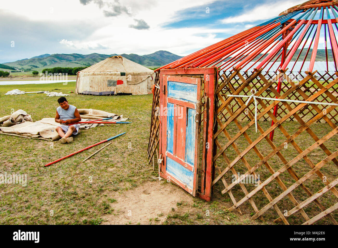 Khutag Ondor, Central Mongolia - July 17, 2010: Nomad constructs a yurt, called a ger, on Central Mongolian steppe - Stock Image