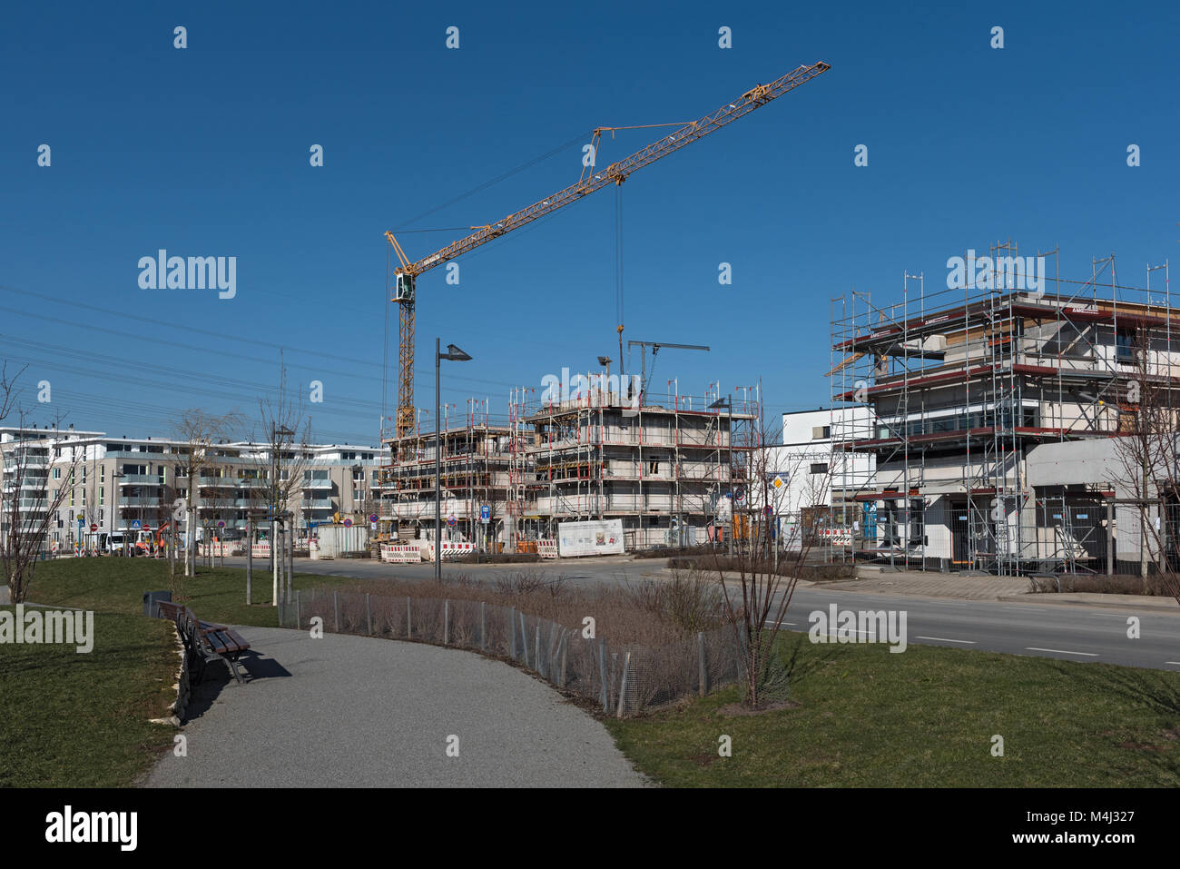 Construction site of several residential buildings in the new district of Riedberg - Stock Image