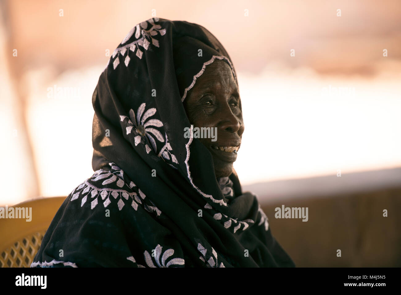 Against tradition, the current Alkalo (head or chief) of the Gambian village where Kunta Kinte is said to have been - Stock Image