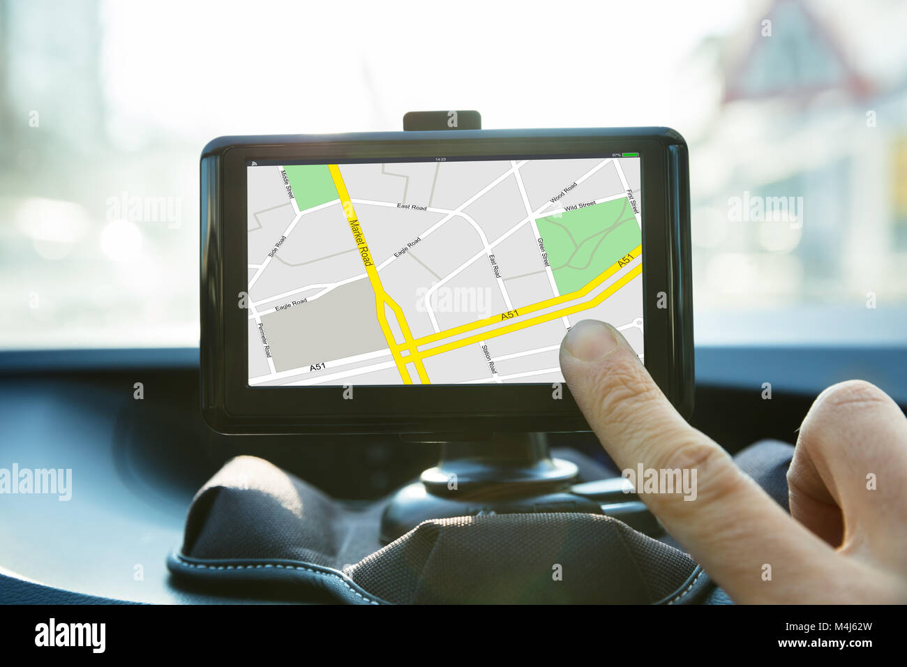 Close-up Of A Person Operating Navigational System Inside A Car - Stock Image