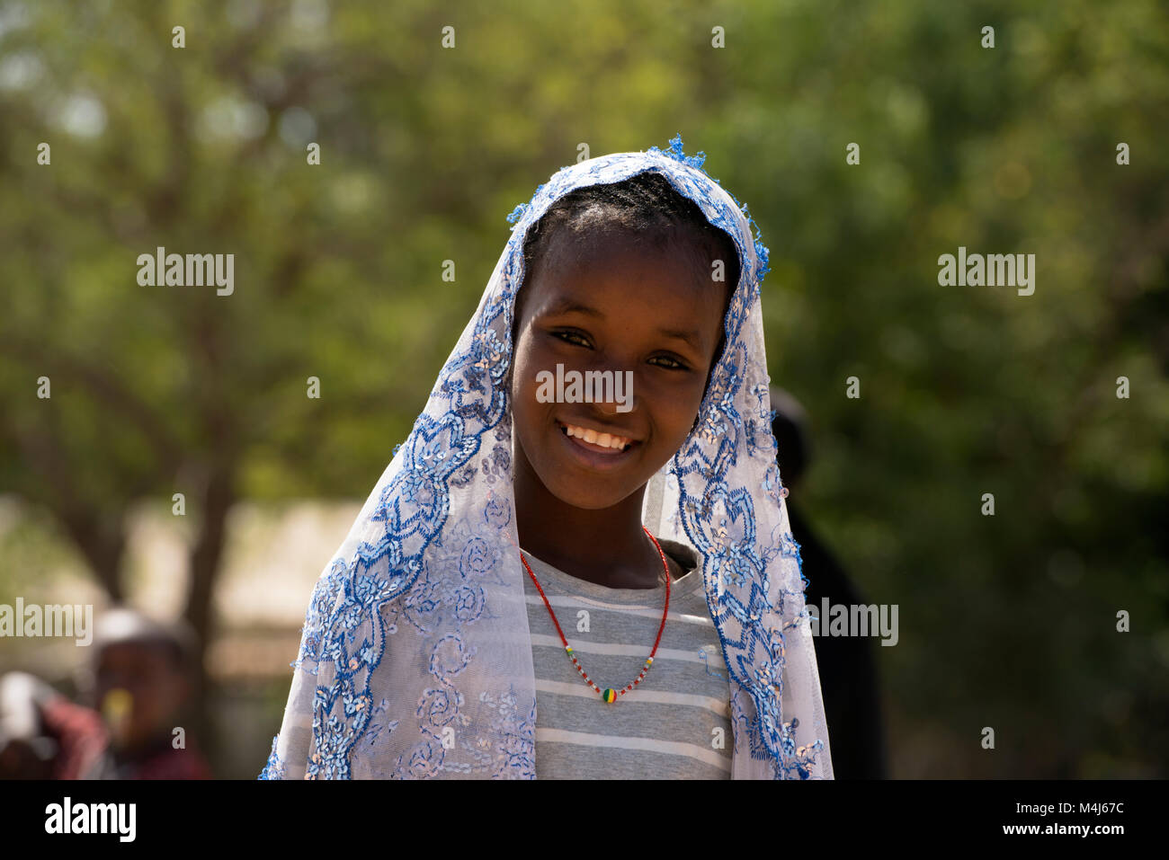 A young Mandinka (Mandingo) girl in her village in The Gambia, West Africa. - Stock Image