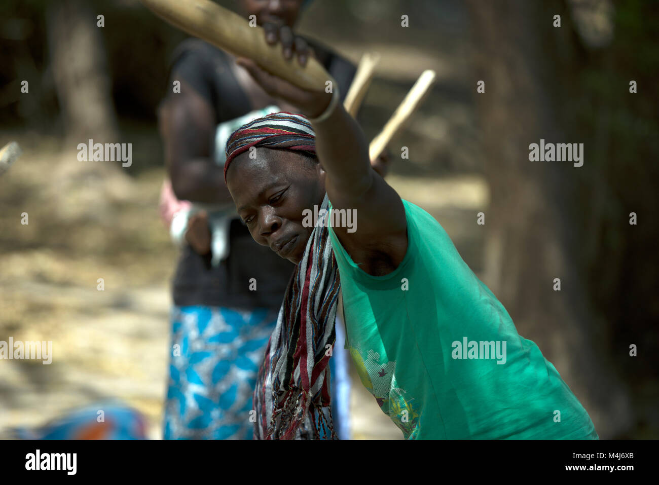 An ethnic Mandingo (Mandinka) woman dances during a traditional, ceremonial music performance in her village, The - Stock Image
