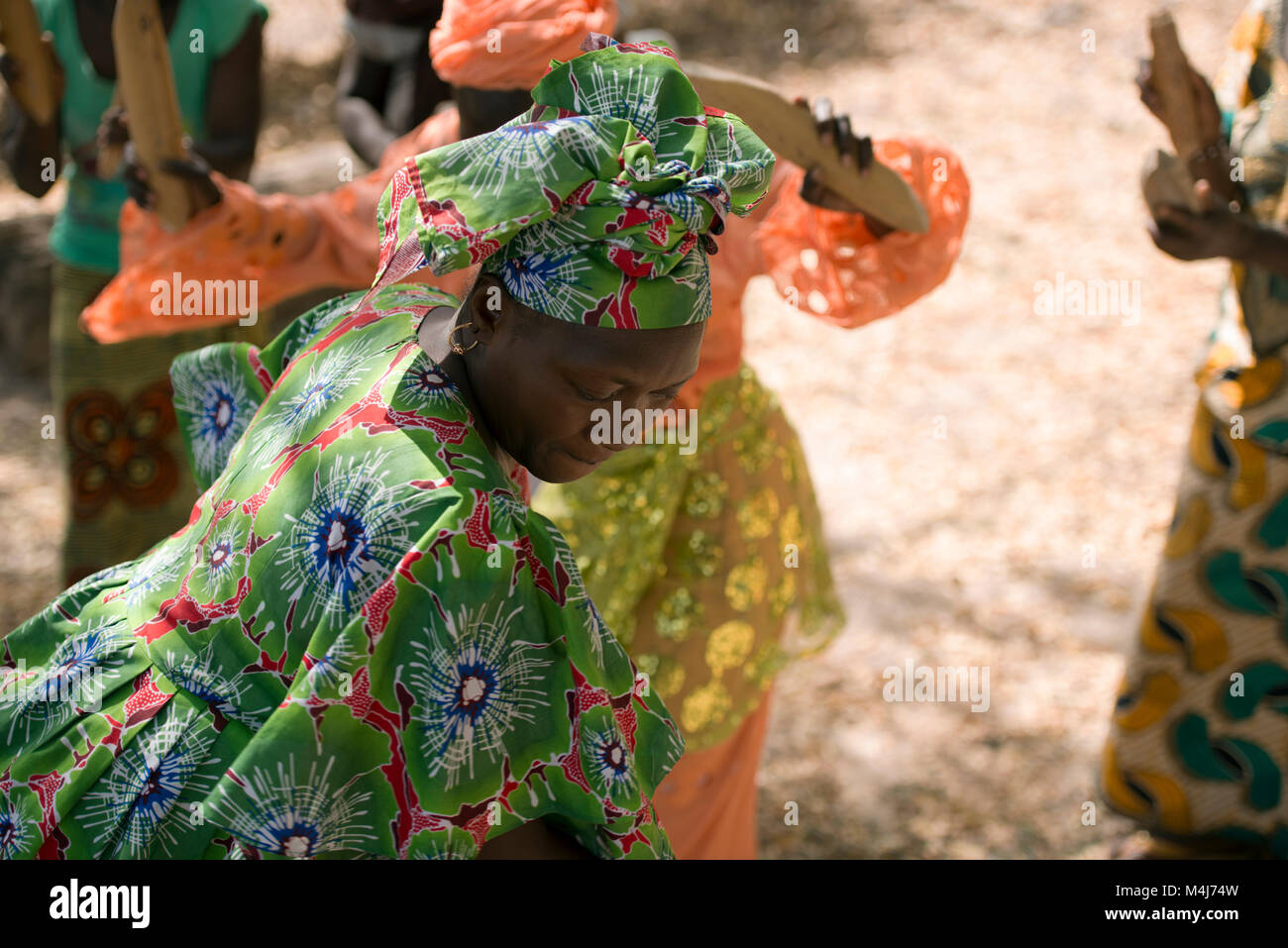 An indigenous, ethnic Mandinka (Mandingo) tribe woman performing a traditional, ceremonial dance in her village, - Stock Image