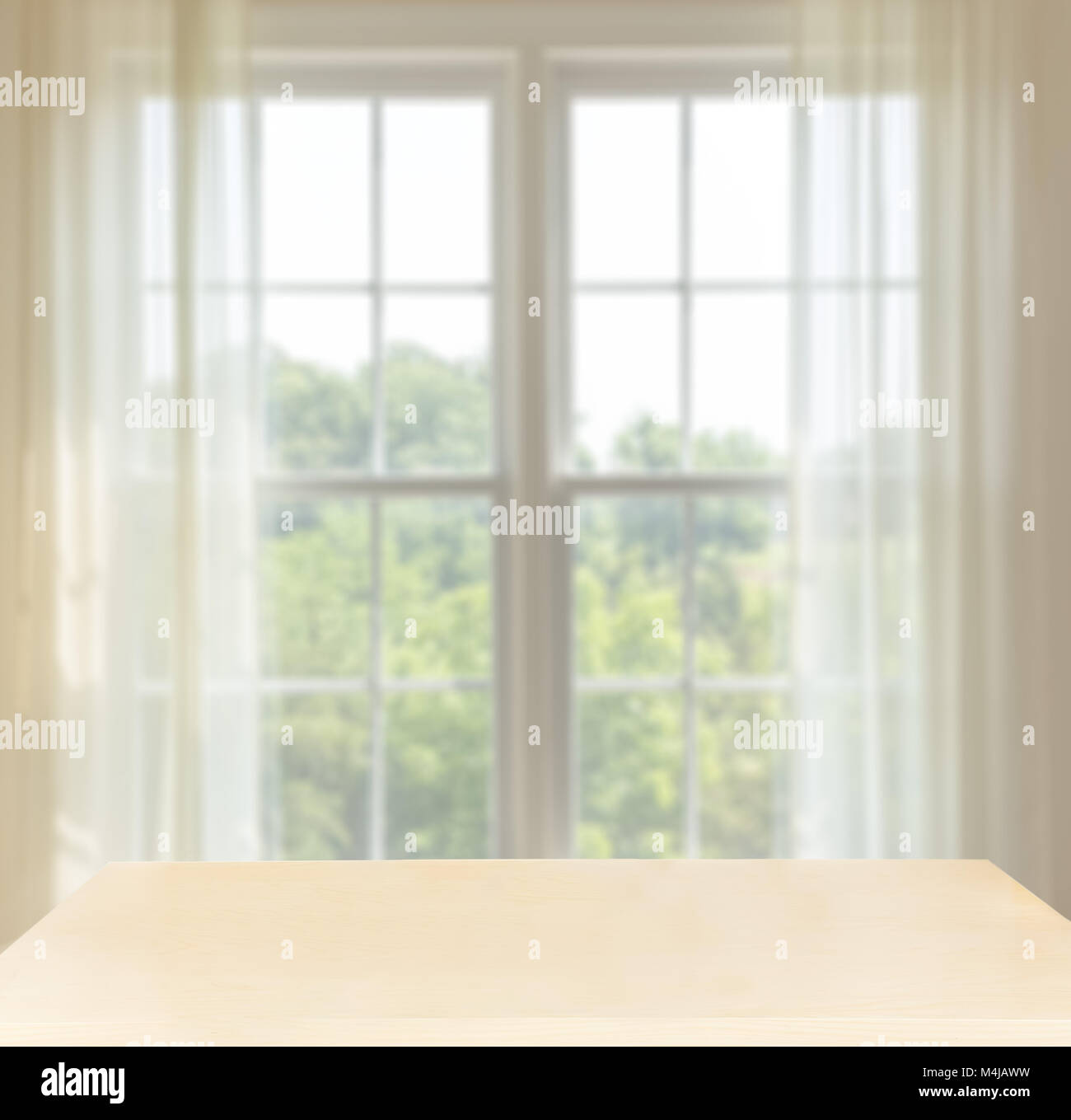 Wooden desk in front of window with space for composites - Stock Image