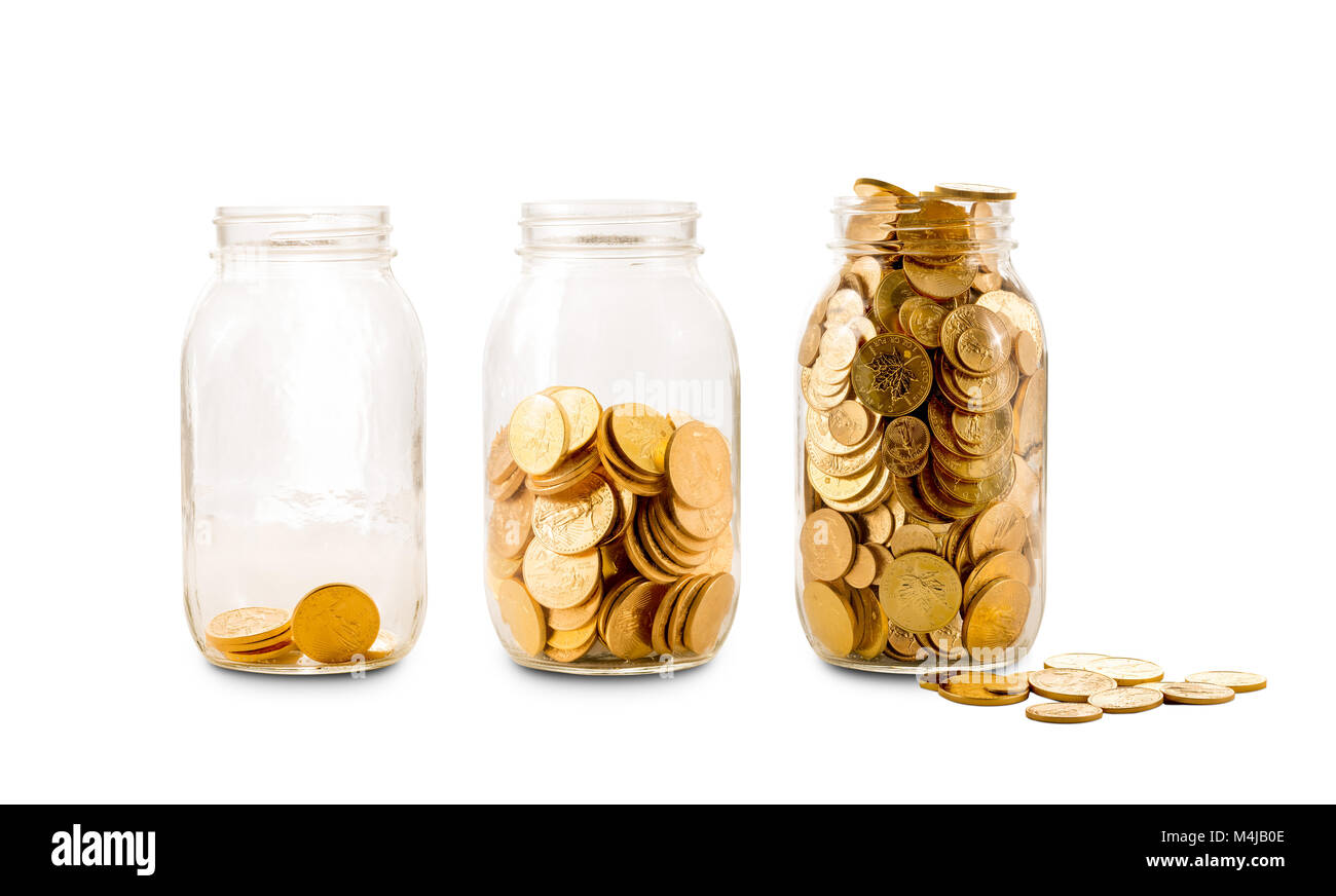 Many gold coins in three glass bottles - Stock Image