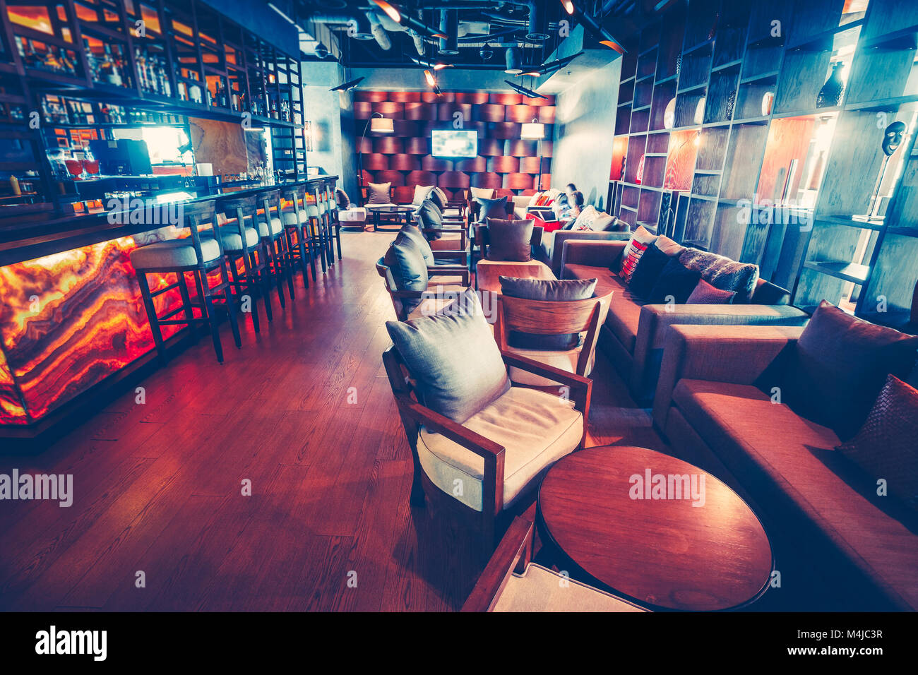 Stylish Modern Interior Of The Cozy Restaurant In Dark Blue And Red Stock Photo Alamy