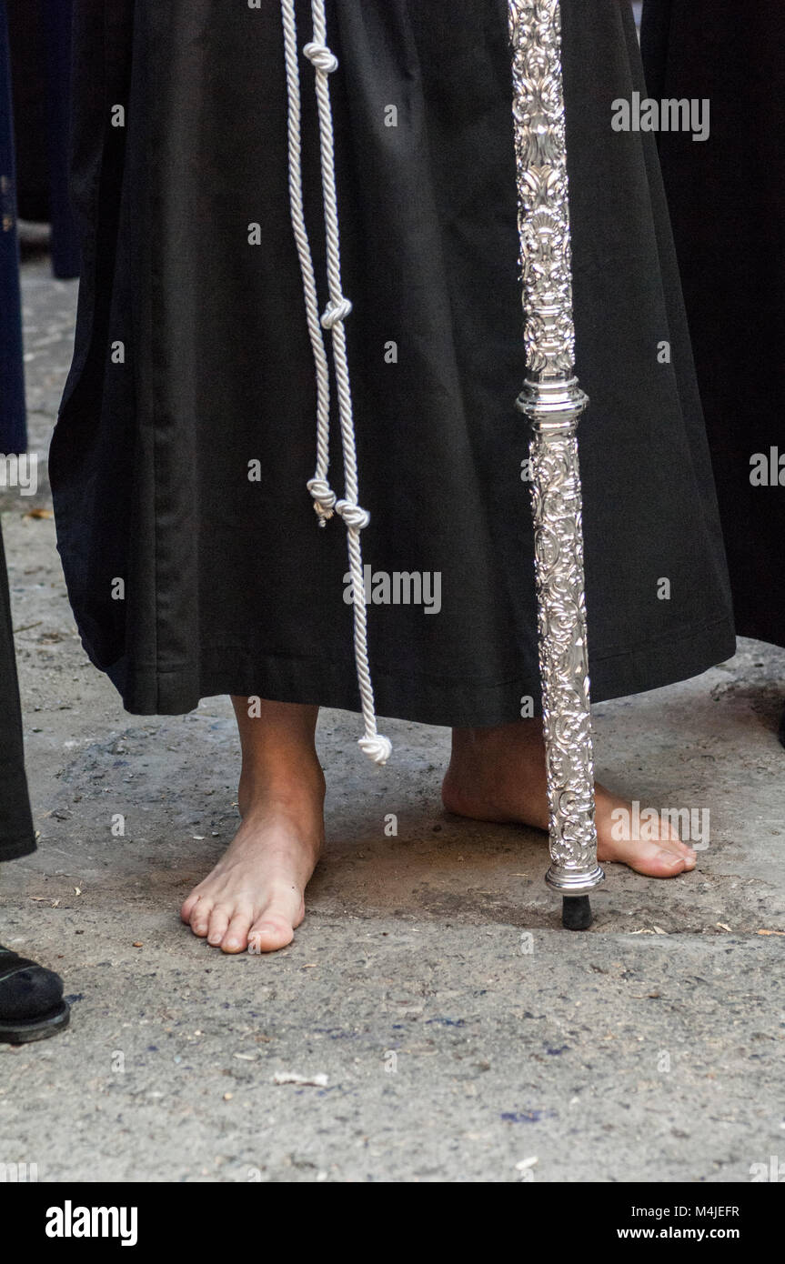 Detail of a penitent performing the penance station with bare feet. Stock Photo