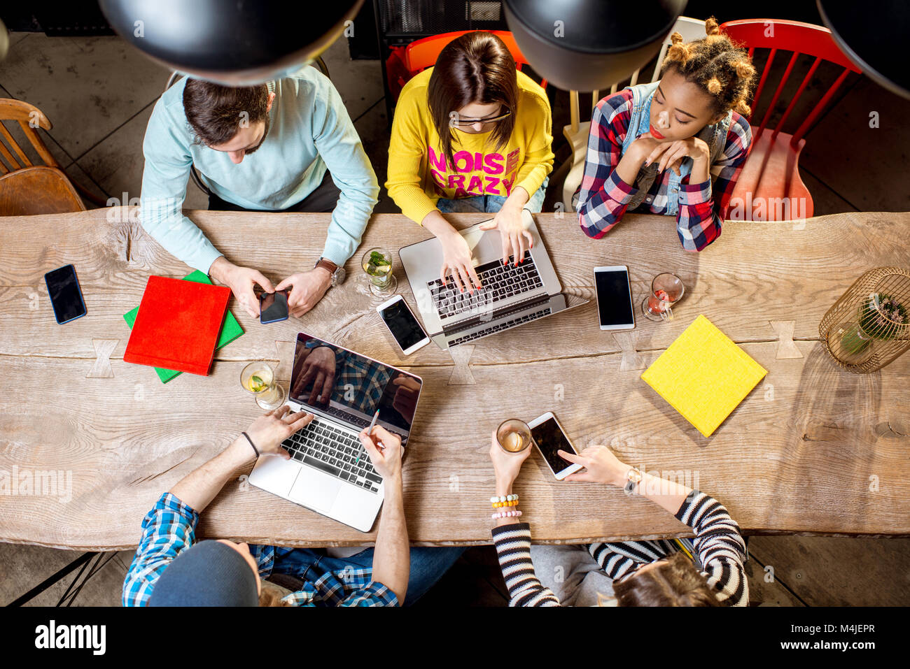 People working with laptops and phones - Stock Image