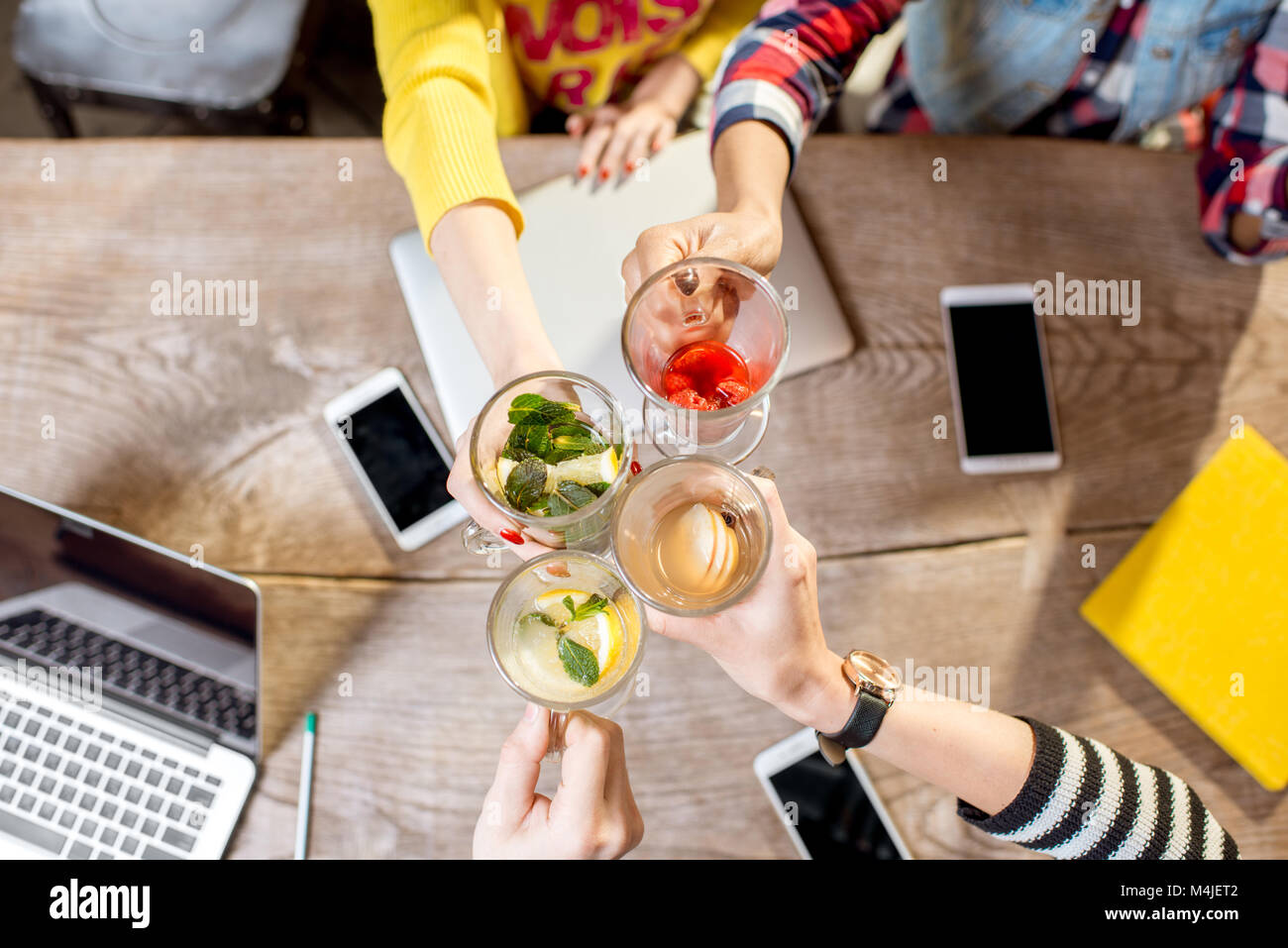 Clinking glasses with teas - Stock Image