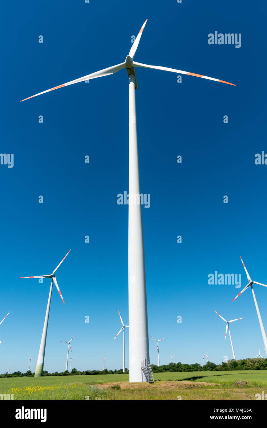 Wind farm with many wind wheels seen in Germany - Stock Image