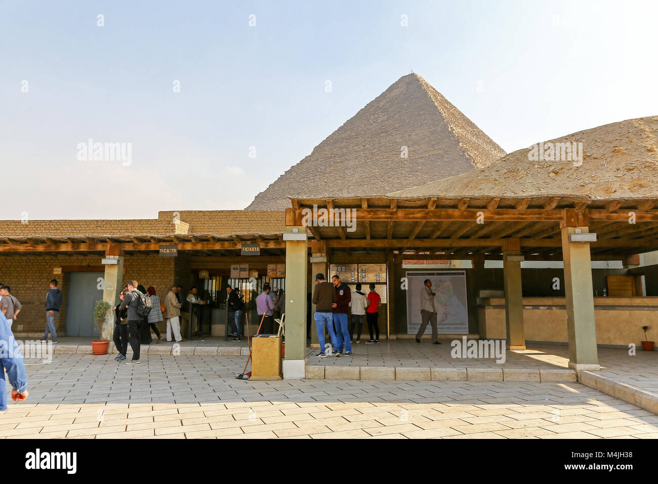 Tourists queuing up to pay at a kiosk to enter to see the Pyramids, Giza, Egypt, North Africa - Stock Image