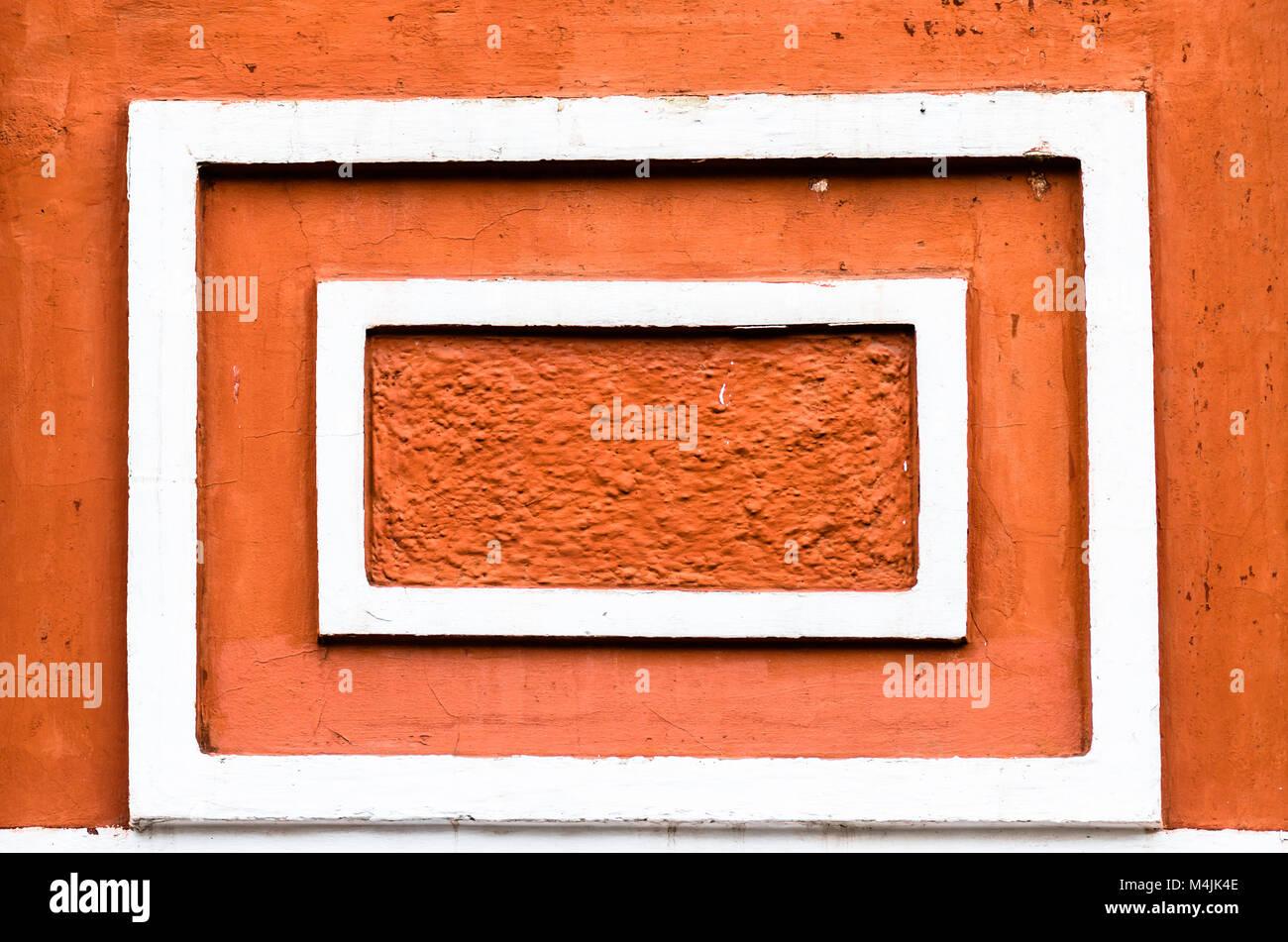 white vintage frames on orange wall. - Stock Image