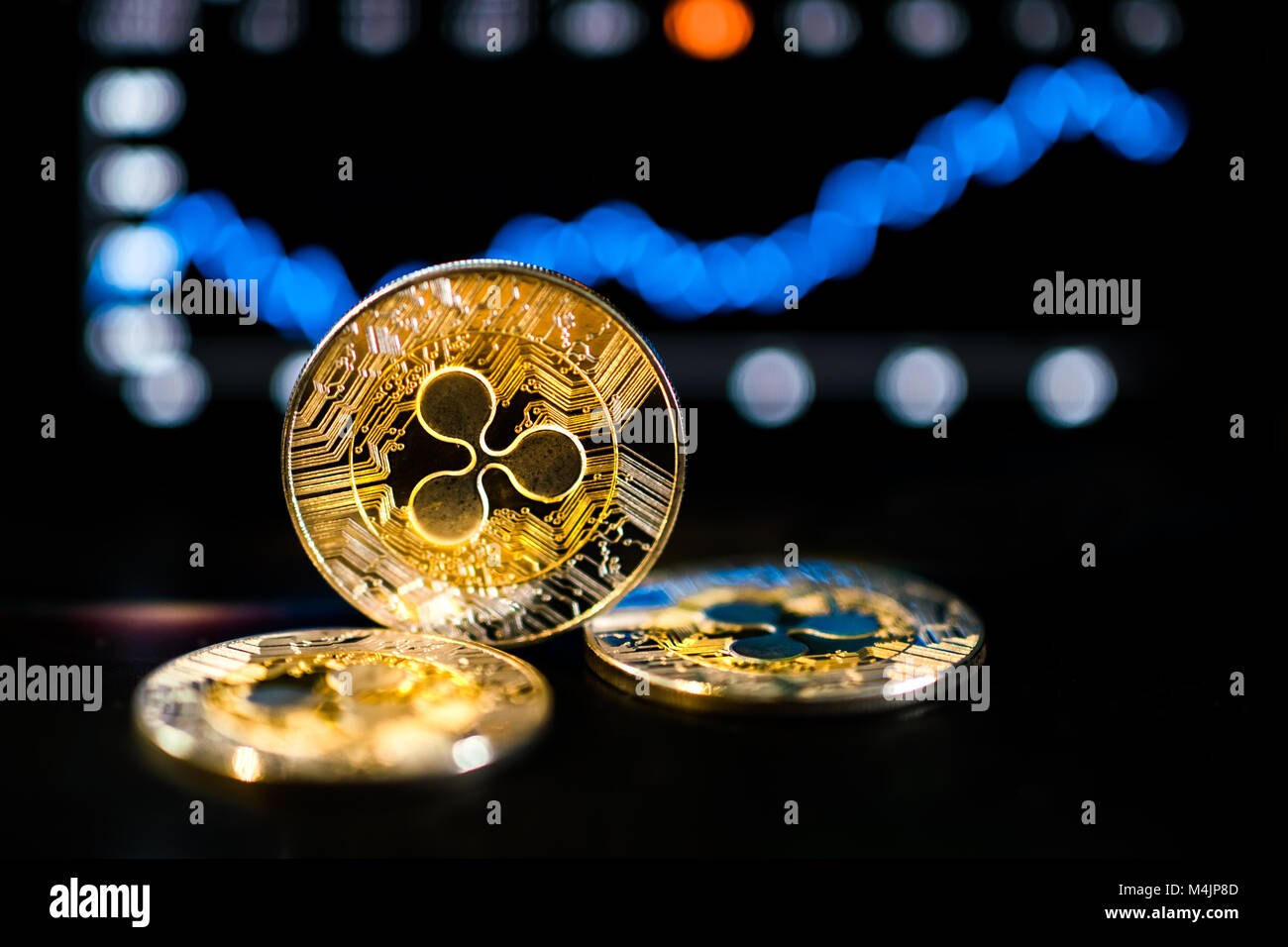 Ripple XRP crypto currency showing bullish signs on market with chart going up - Stock Image