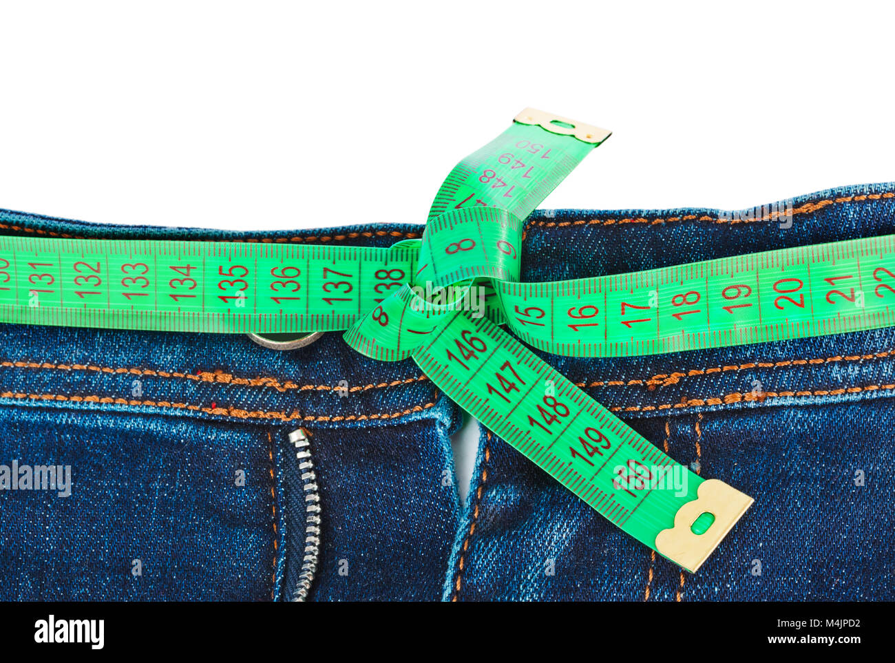Jeans and measuring tape - slimming concept - Stock Image