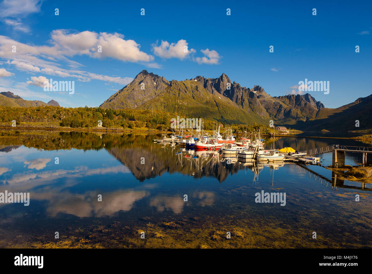 Fishing boats and yachts on Lofoten islands in Norway Stock Photo