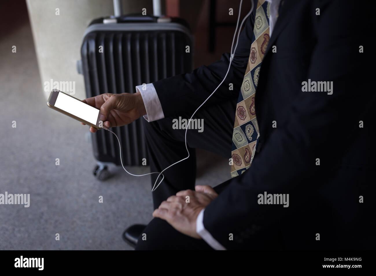 Businessman using a smart phone - Stock Image