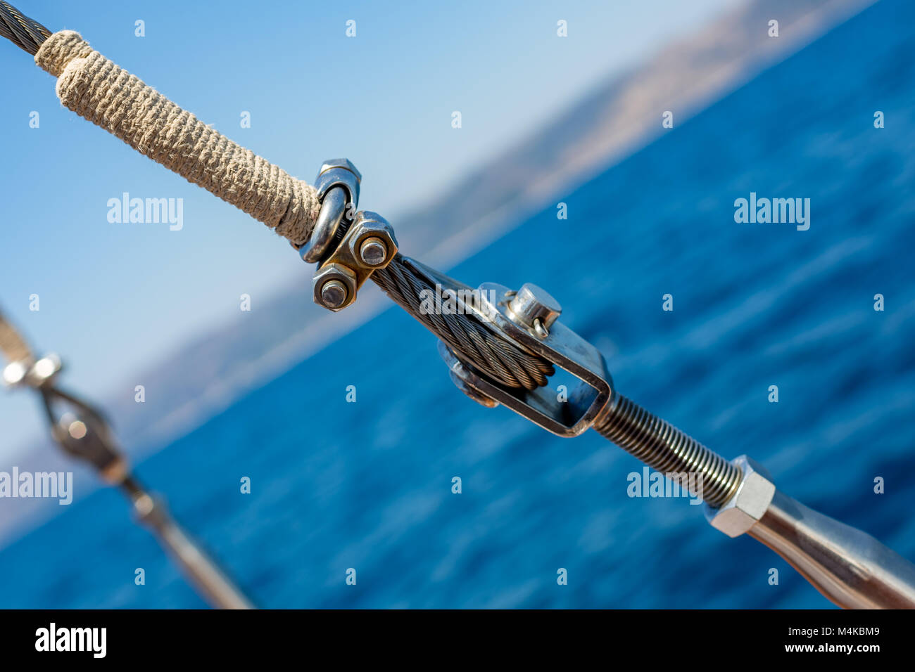 Diagonal ship metallic rope with nuts and bolts - Stock Image