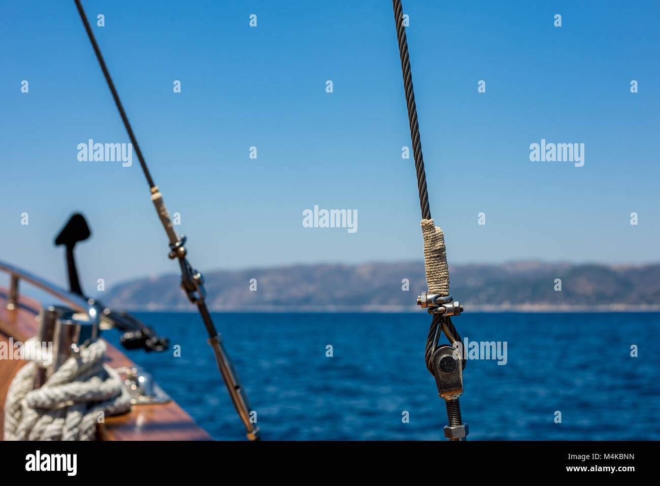 Metallic ship rope with nuts and bolts - Stock Image