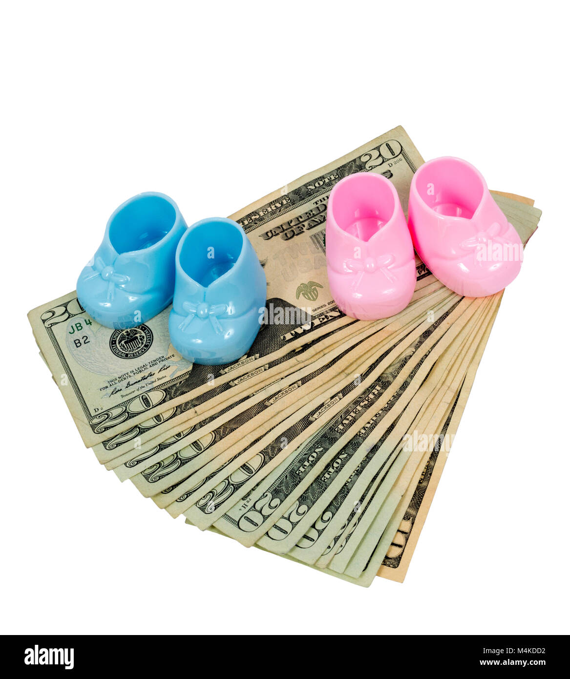 Vertical shot of a pair of Pink and Blue Plastic Booties Sitting on Fanned Out Twenty Dollar Bills With a Ten at Stock Photo