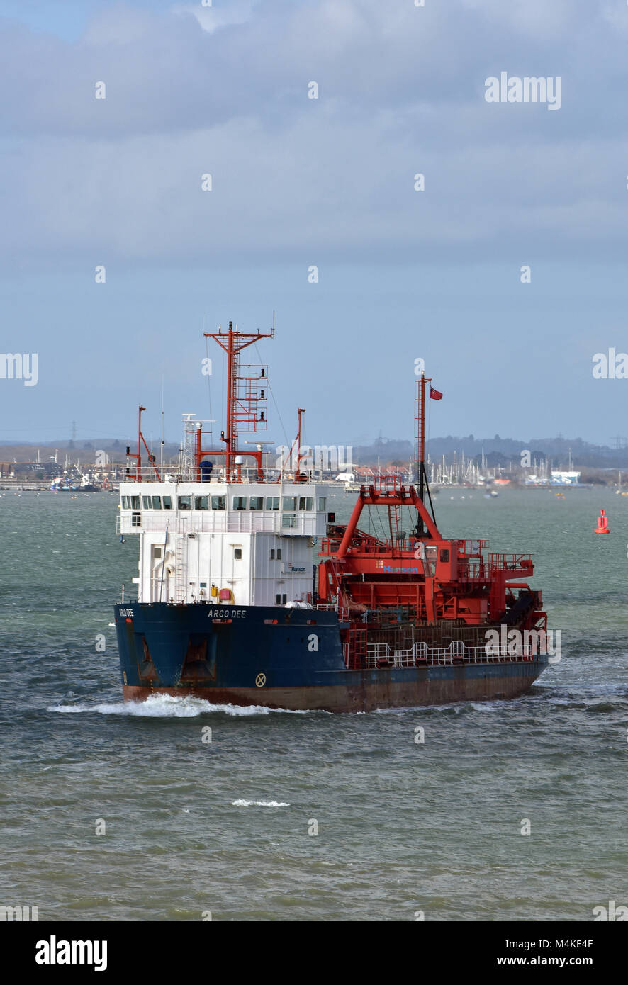 the arco axe dredger or dredging ship leaving the port of southampton. - Stock Image