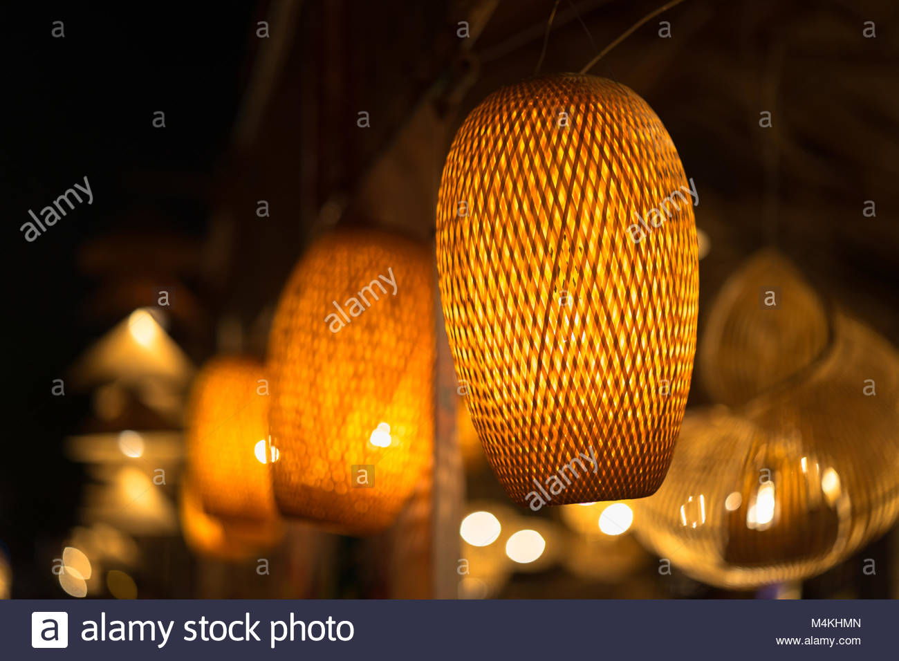 https://c8.alamy.com/comp/M4KHMN/decorating-hanging-lantern-lamps-in-wooden-wicker-made-from-bamboo-M4KHMN.jpg