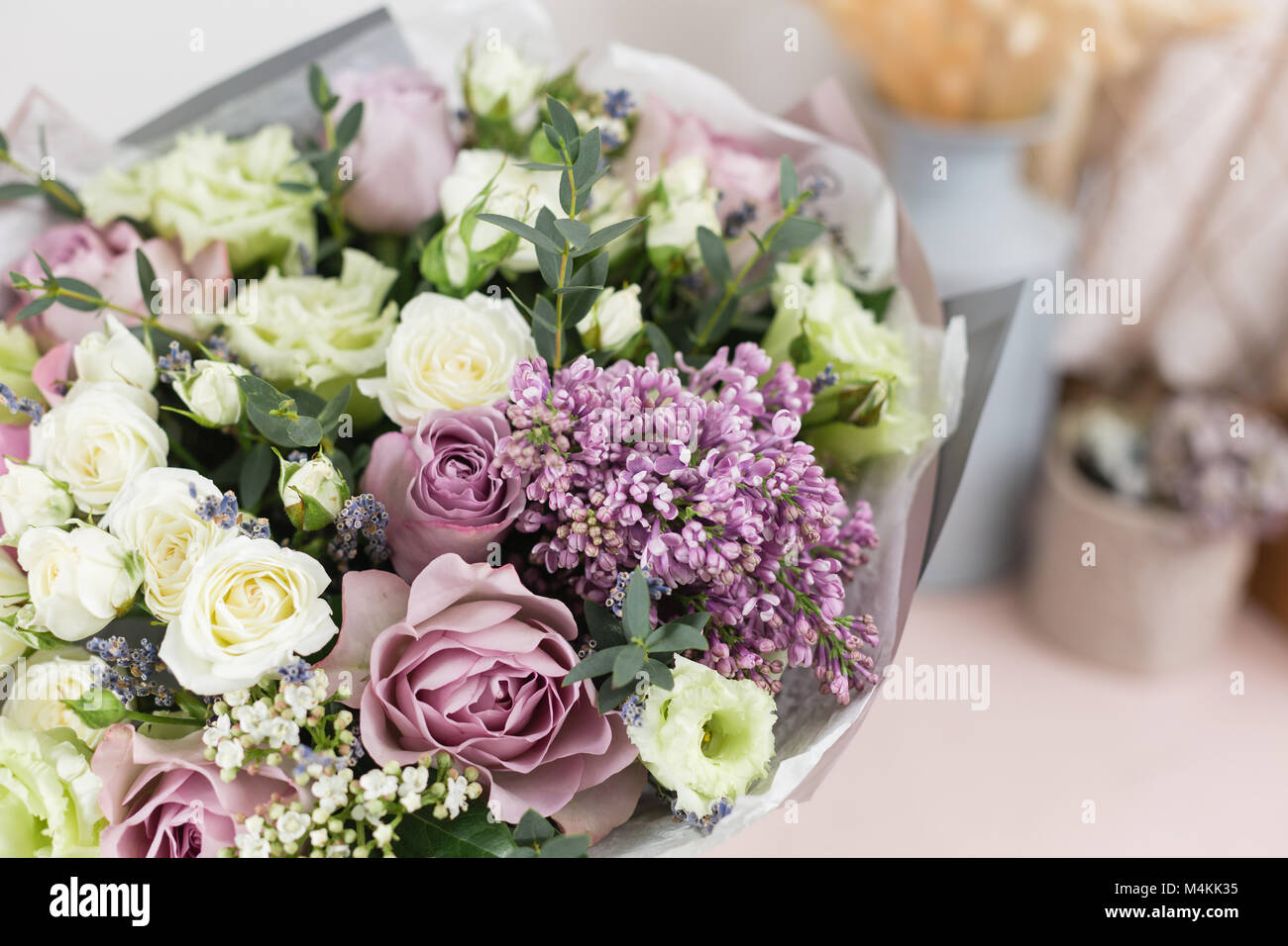 Flower shop concept close up beautiful luxury bouquet of mixed flower shop concept close up beautiful luxury bouquet of mixed flowers on wooden table wallpaper izmirmasajfo Choice Image