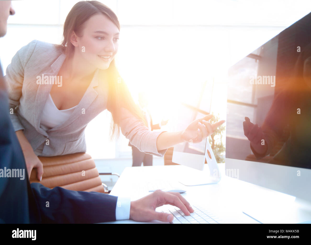 business woman pointing at the computer screen.photo with copy space - Stock Image